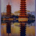 China: two pagodas reflected in a lake