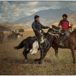 Men on horseback play the oriental polo called Buzhkazi