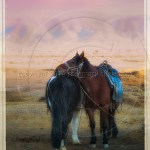 Mongolian horses stand in a landscape of magical pastel colors