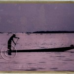 silhouette of rower on Inle Lake