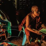 a teaching monk sits amidst his books