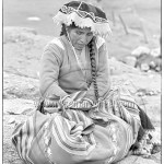 a Quechua woman rests on her way to market
