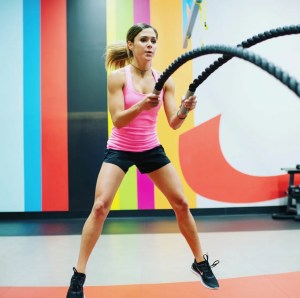 Darby using the battle ropes to get a good workout