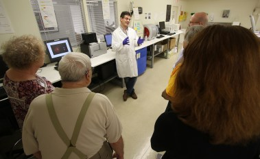 Dr. Daniel Paris explaining some of the equipment in the lab.