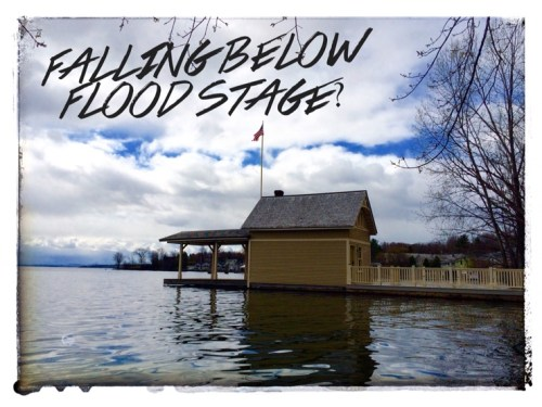 Is the Lake Champlain water level falling below flood stage?
