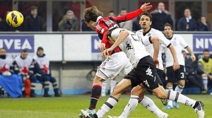 AC Milan's Bojan Krkic scores against Siena during their Italian Serie A soccer match at San Siro stadium in Milan
