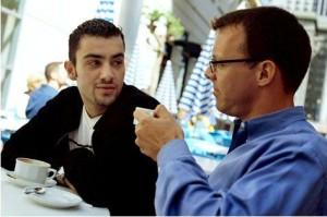two-guys-talking-in-coffeeshop-300x199