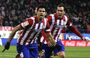 Atletico Madrid's Diego Costa celebrates his goal against Levante with teammate Diego Godin during their Spanish first division soccer match in Madrid