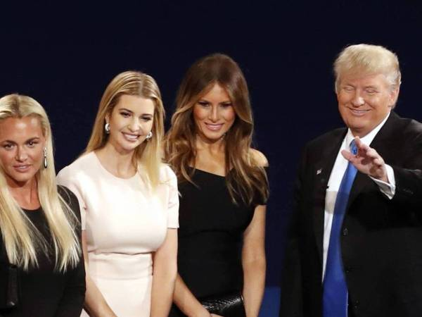 Republican presidential nominee Donald Trump, second from left, his wife Melania Trump, third from left, and family members appear on stage after the presidential debate with Democratic presidential nominee Hillary Clinton at Hofstra University in Hempstead, N.Y., Monday, Sept. 26, 2016. (AP Photo/Mary Altaffer)