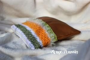 Création de Rouge Poussin : Pochette en cuir et laine