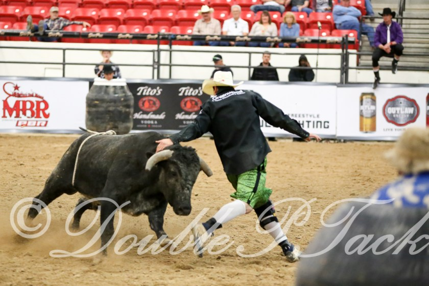 Action photos from the Ultimate Freestyle Bullfighting Championship at the PBR Fan Zone during the PBR BlueDef Finals. Photos from Double P Tack