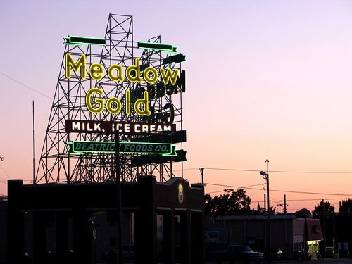 Homeless people camping out at Meadow Gold sign in Tulsa