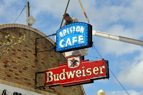 Restored Ariston Cafe sign reinstalled; relighting ceremony is Saturday