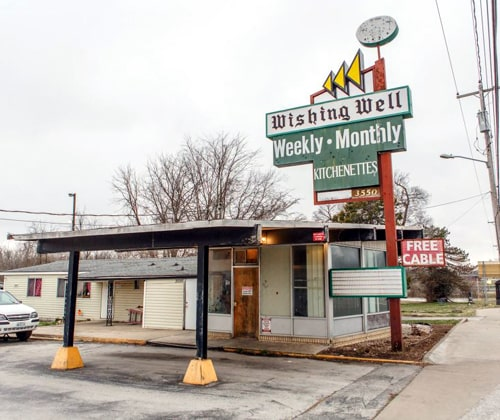 Will the Wishing Well Motor Inn's sign be saved?