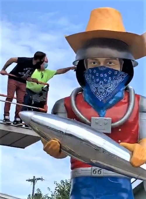 Buck Atom fiberglass giant in Tulsa gets its own face mask