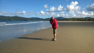 A photographer on Thornton Beach, Daintree Rainforest