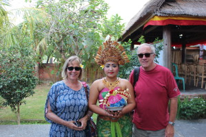 Two tourists and a Balinese barong dancer
