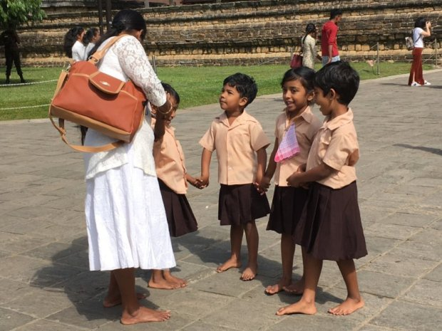Children on the way to ceremony, Temple of the Tooth