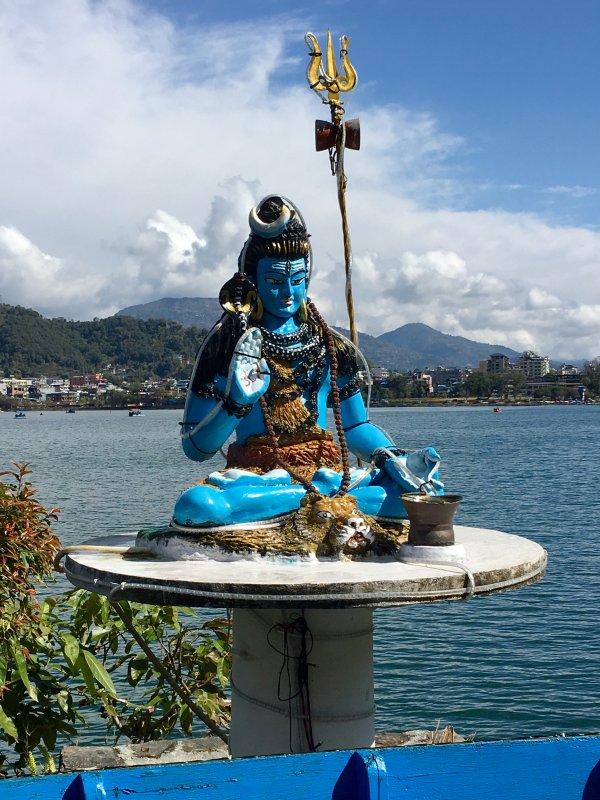 Blue statue behind Lake Phewa, Pokhara