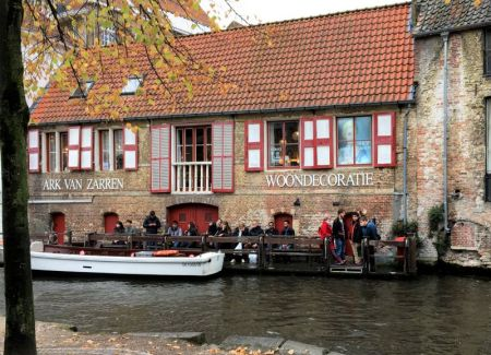 River cruising through Belgium and the Netherlands: Bruges canalside cafe