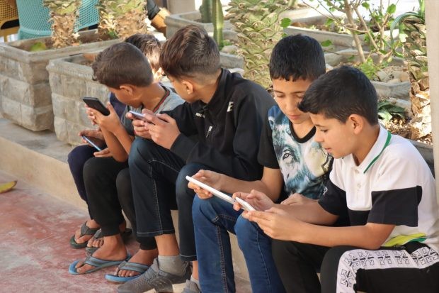 Moroccan boys with their mobile phones