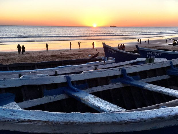 Taghazout, people on the beach at sunset