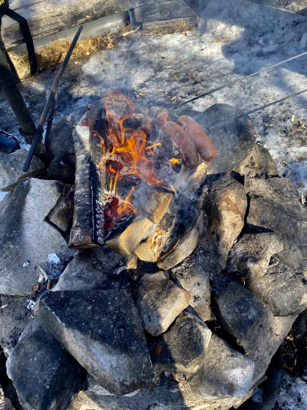 Arctic Lapland spring: sausages on fire