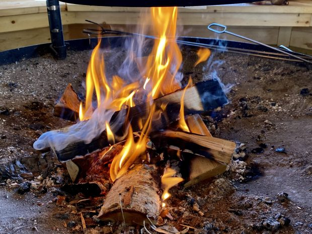Arctic Lapland spring: campfire in a wilderness hut