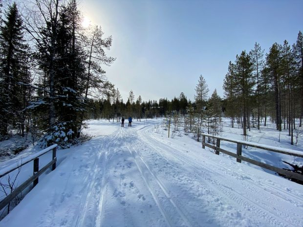 Arctic Lapland spring: crossing a mountain river