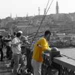 Galata Bridge Istanbul Turkey Fisherman in Yellow Tee shirt