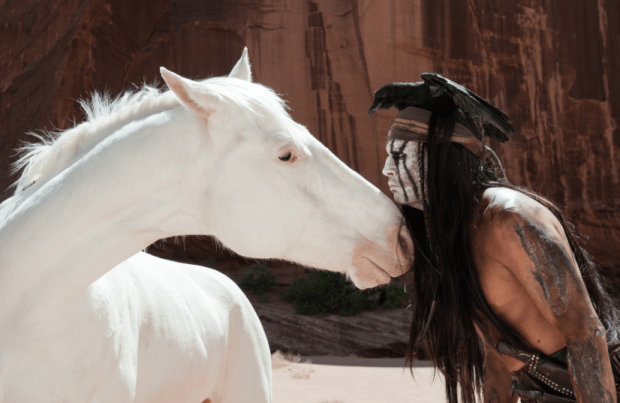 Johnny Depp in Lone Ranger with white horse