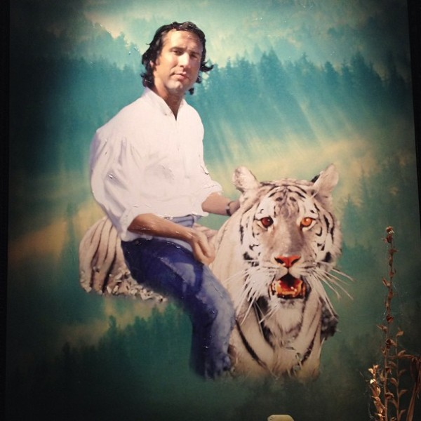Weird Painting of Chevy Chase Riding a White Tiger