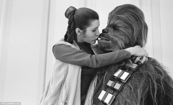 Princess Leia (Carrie Fisher) and Chewbacca (Peter Mayhew) about to kiss - Star Wars Empire Strikes Back Behind the Scenes