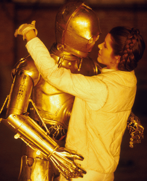 Princess Leia (Carrie Fisher) and C-3PO (Anthony Daniels) about to kiss - Star Wars Empire Strikes Back Behind the Scenes