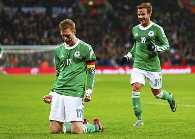 Germany's Mertesacker celebrates with Goetze after scoring a goal against England during their international friendly soccer match at Wembley Stadium in London