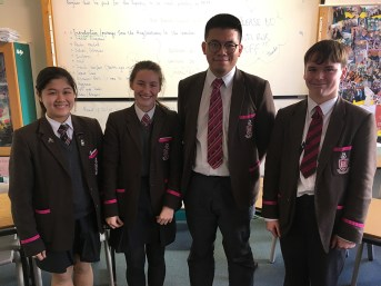 Angie Lam, Emily Carson and Hugo Ho (all Year 13) with Benjamin Neill (Year 10)