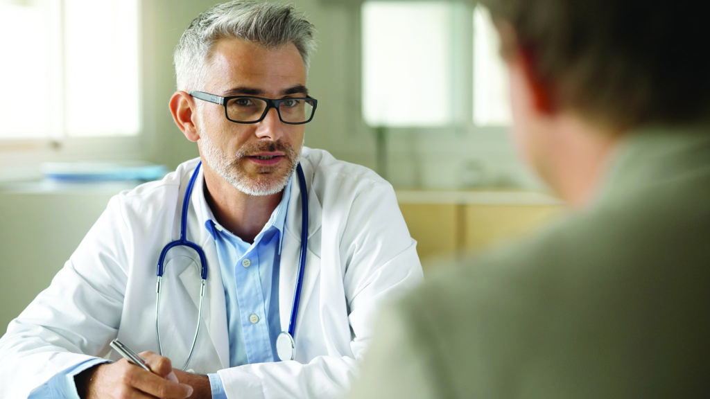 Patient in discussion with doctor