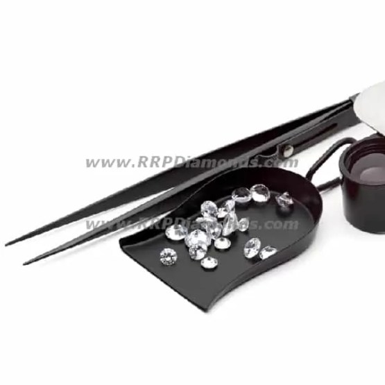 Black Scoop, Tweezers And Loupe With Loose Diamond