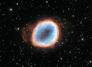 A dying star's final moments are captured in this image from the NASA/ESA Hubble Space Telescope. The death throes of this star may only last mere moments on a cosmological timescale, but this star's demise is still quite lengthy by our standards, lasting tens of thousands of years! The star's agony has culminated in a wonderful planetary nebula known as NGC 6565, a cloud of gas that was ejected from the star after strong stellar winds pushed the star's outer layers away into space. Once enough material was ejected, the star's luminous core was exposed and it began to produce ultraviolet radiation, exciting the surrounding gas to varying degrees and causing it to radiate in an attractive array of colours. These same colours can be seen in the famous and impressive Ring Nebula (heic1310), a prominent example of a nebula like this one. Planetary nebulae are illuminated for around 10 000 years before the central star begins to cool and shrink to become a white dwarf. When this happens, the star's light drastically diminishes and ceases to excite the surrounding gas, so the nebula fades from view. A version of this image was entered into the Hubble's Hidden Treasures basic image competition by contestant Matej Novak.