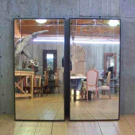 pair of steel framed mirrors