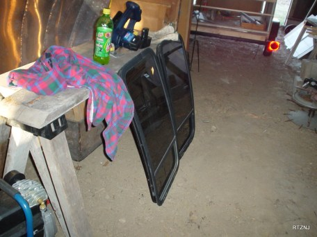I re-used the rear windows from my Dad's Dodge Van. Had to figure out how to get a curved window to fit into a flat door.