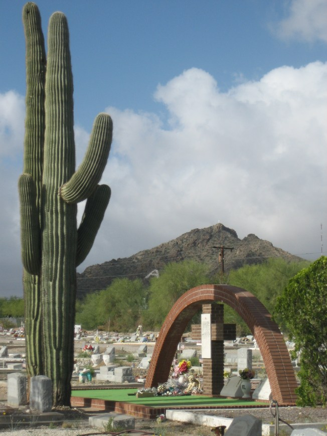 "I love this photo with the two saguaros presiding over Ajo Cemetery with A mountain in the background. I wasn't even trying to get the mountain in the background, and I didn't realize the Ajo ""A"" would show up so clearly. This is one of those photos I look at and think, how did I do that?"