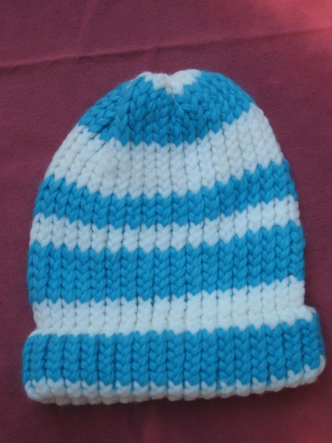 This blue and white hat has a finished edge. The yarn is very thick. This will be a warm, warm hat.