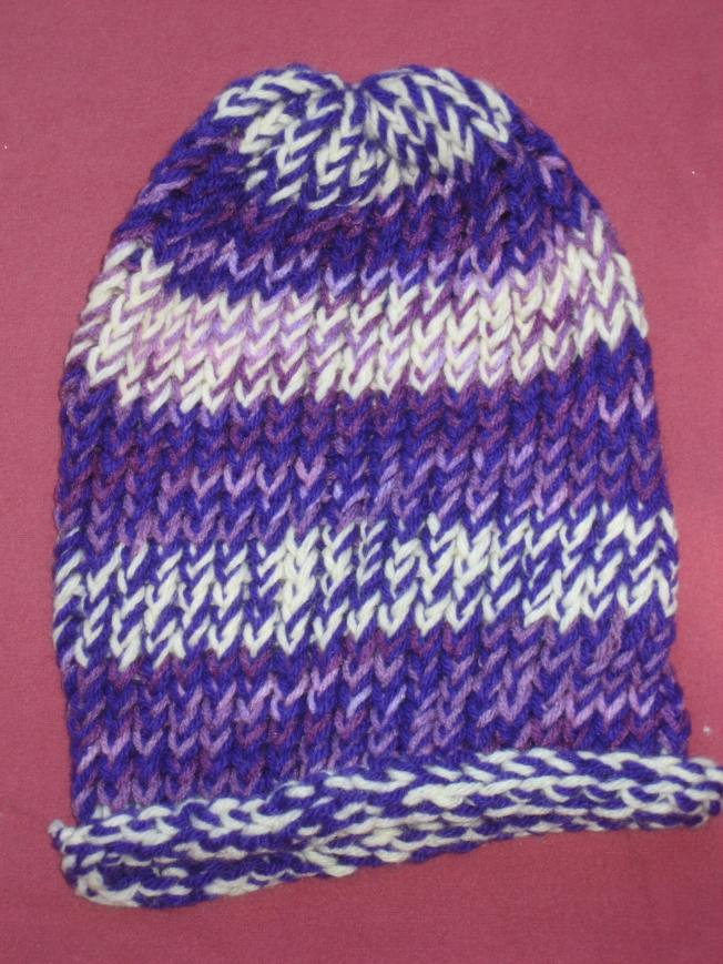 This large hat has an unfinished edge. It is quite purple, and costs $13, including postage.