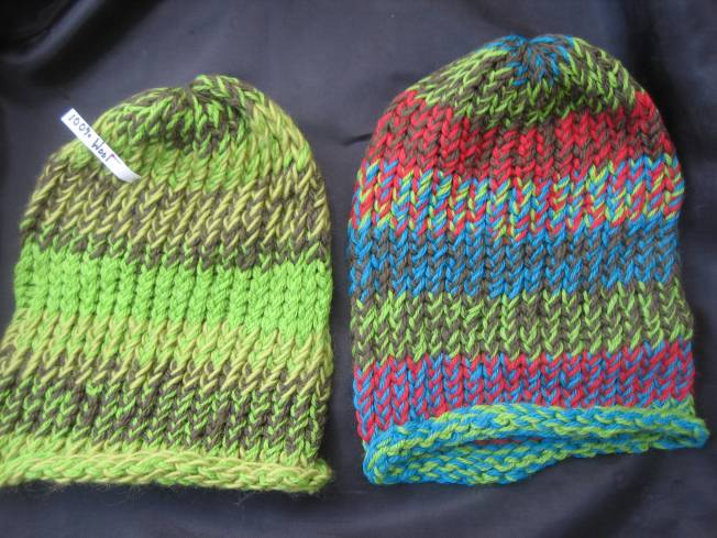 Both of these hats are made from 100% wool yarn. Both have a rolled edge, and both cost $20, including postage.