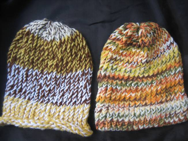 These large hats come in fall color schemes. The one on the left has a rolled edge and the one on the right has a finished edge that can be folded up or worn down for added ear coverage. Each hat costs $13, including postage.
