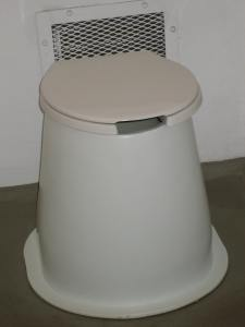 This is a pit toilet. It works thanks to gravity.