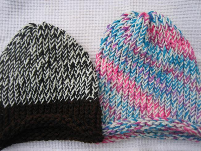 These two large hats are for sale. Both have rolled edges, and both are suitable for adults. Each costs $13, including postage.