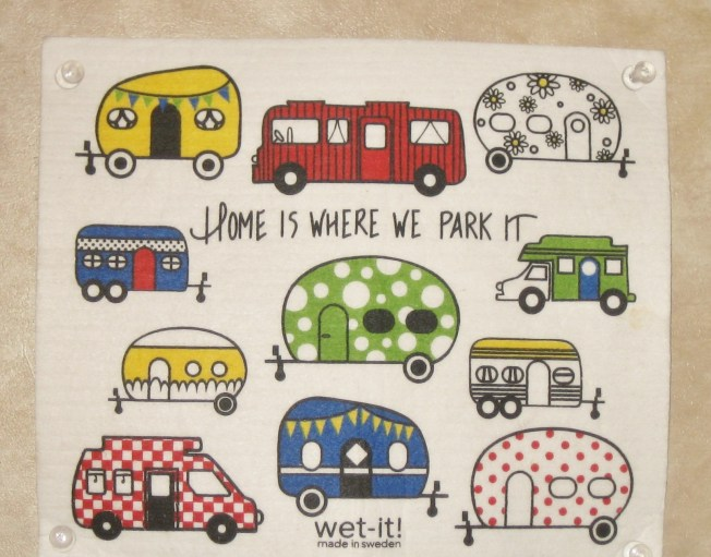 Colorful drawings of travel trailers and camper vans surround the words Home Is Where We Park It.