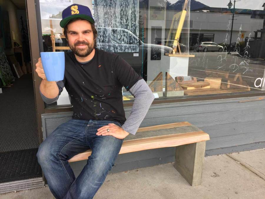 Andy enjoying a coffee on the Mortise and Tenon concrete and cedar bench.